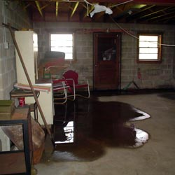 A flooded basement showing groundwater intrusion in Minneapolis